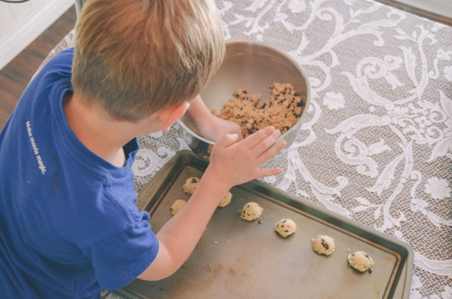 mini chocolate chip cookies on the pan for baking